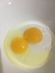 Chicken and duck eggs side by side